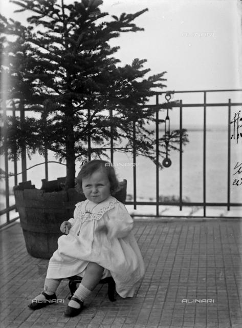 Portrait of little girl in a terrace