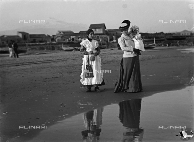 Portrait of a Lady with child and nurse on the beach in Catania