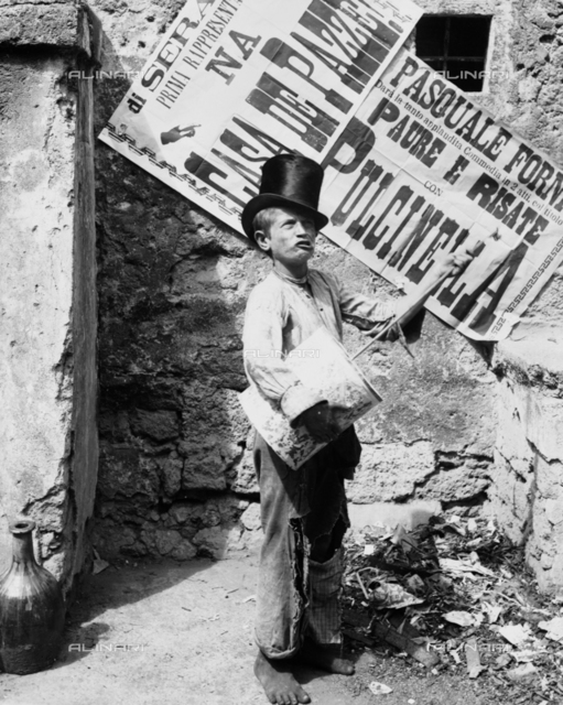 """Child with drum and cylinder, traditionally called """"player Putaputa Caccavello"""", a street in Naples"""
