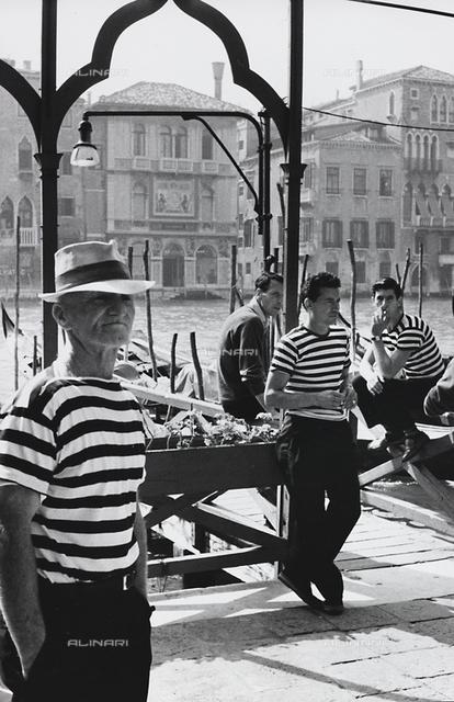 Portrait of gondoliers, Venice