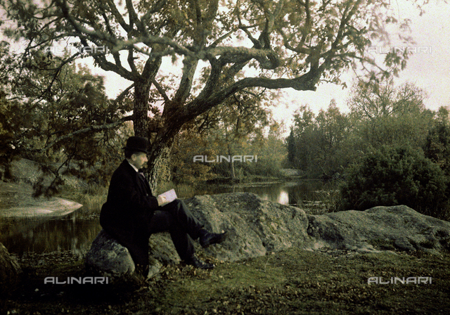 Man reading a book in Fontainebleau forest