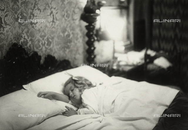 A child sleeping soundly in a bedroom of the house of the photographer Mario Castagneri