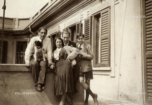 The photographer Mario Castagneri with his wife, two children and their dog, on the terrace of their home in Via Vittorio Veneto in Milan