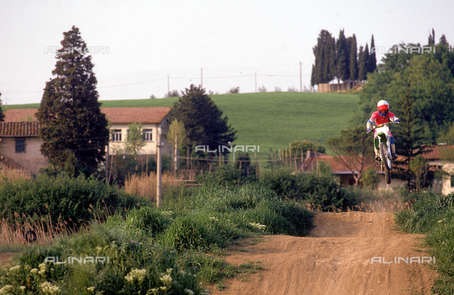 Stretch of a motocross track and a motorcyclist. Environs of Castelnuovo d'Elsa, Castelfiorentino, Florence.