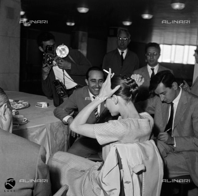 Audrey Hepburn meeting journalists upon her arrival to Fiumicino airport