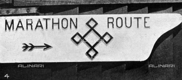 "London Olympics in 1908: Sign post marking the direction of the marathon route. The race started in Windsor and ended in the stadium in Shepherd's Bush, London. Photograph published in ""The Illustrated Sporting and Dramatic"" of July 25, 1908 p. 844"