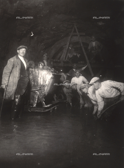 A group of workers at task in a tunnel at Fianona, Istria, photographed during the period of Italy's reign in Istria