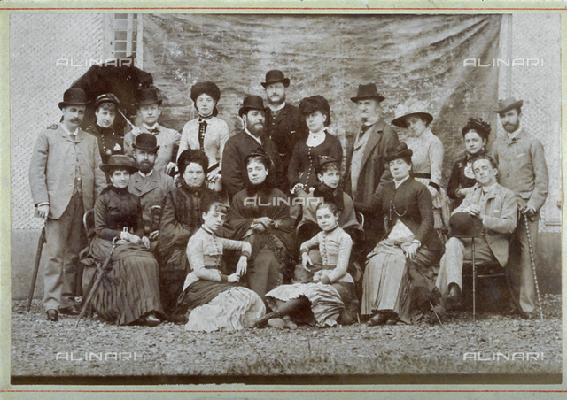 Portrait of a large group of aristocrats in late 19th century day dress