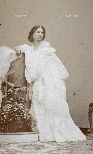 Full-length portrait of a young woman in 19th century style clothes