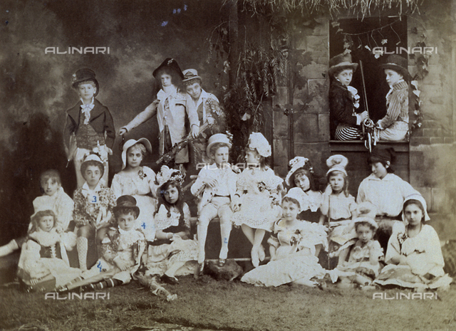 Prince Vittorio Emanuele III of Savoy surrounded by a large group of children in costume, members of Italian nobility