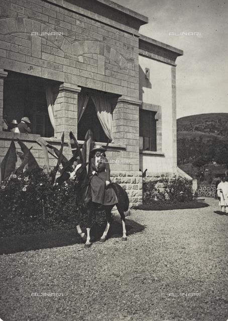Album of the Marquis Giuseppe Colli Felizzano - Ethiopia / Argentina: the Marchioness Colli Felizzano riding in the garden of the Italian Legation, Addis Ababa