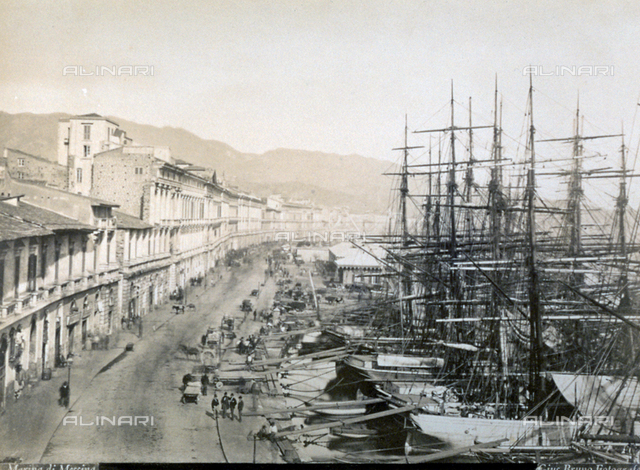 View of the port of Messina with the road, houses, and people