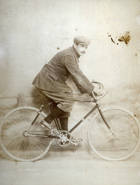 Full-length portrait of a young man on a bicycle
