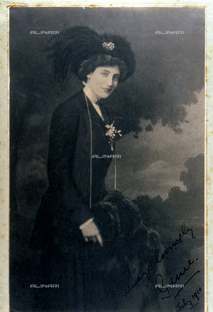 Three-quarter length portrait of the noble Lady Ginie Spinola in elegant attire with a plumed hat