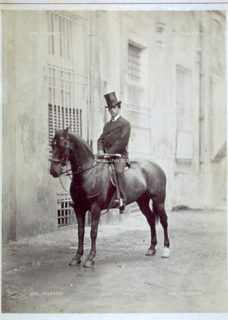 Portrait of a gentleman on horseback, in elegant clothes and top hat