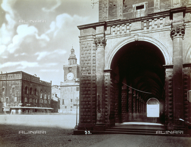 Piazza Maggiore in Bologna (Italy). In the foreground perspective view of the portico of Palazzo del Podestà. In the background, partially visible, the Town Hall