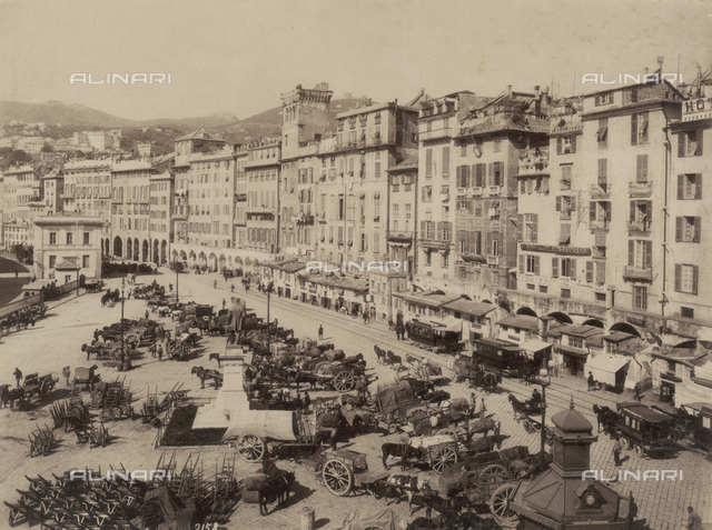 The Piazza Caricamento in Genova, surrounded by tall porticoed buildings