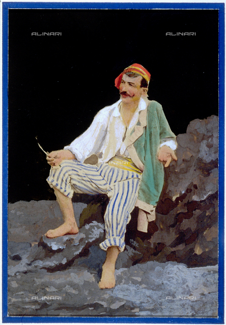 Young man in traditional Neapolitan dress on a rock