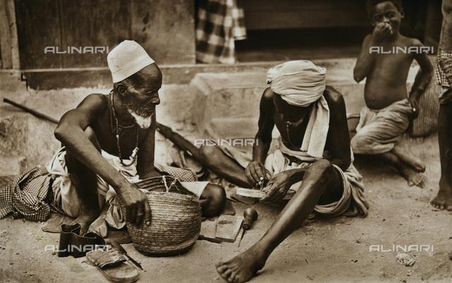 Two elderly cobblers