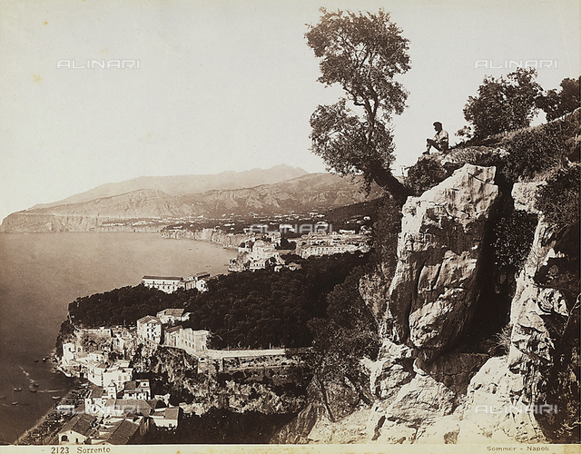Panoramic view of Sorrento and the Sorrento Coast. A man resting on the top of a cliff