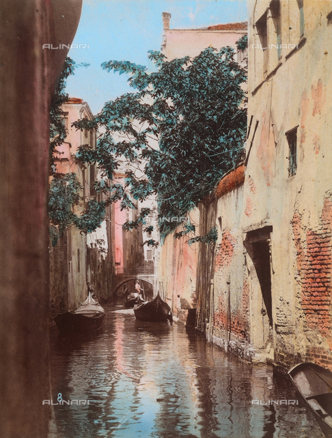 Houses and gondolas along a canal in Venice
