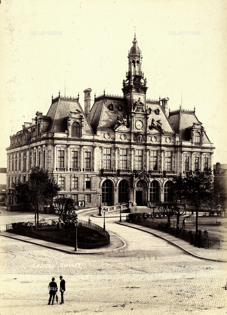 A building in Limoges. Two men talking in the square in front