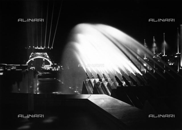 World's Fair of 1937: night view with spectacular sprays of water from a fountain in front of the Eiffel Tower.
