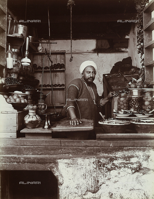 A Turkish food vendor, photographed behind the counter of his shop