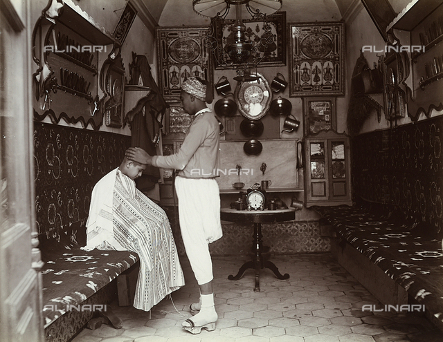 A Turkish barber and his client in his shop