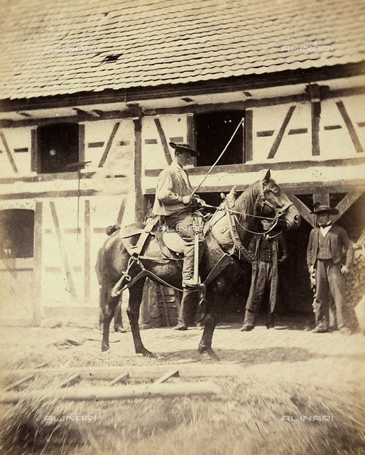 An Alsatian horse tamer photographed on a horse