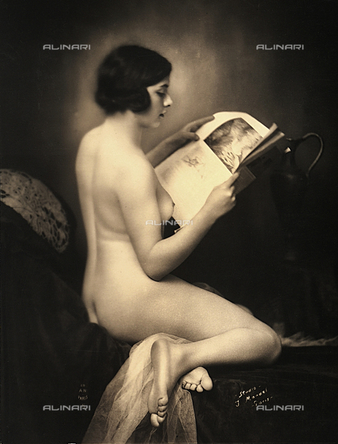 Female nude with newspaper