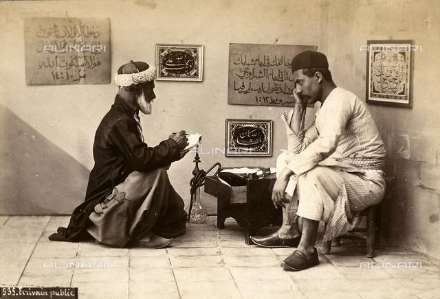 A Syrian public scribe facing a client