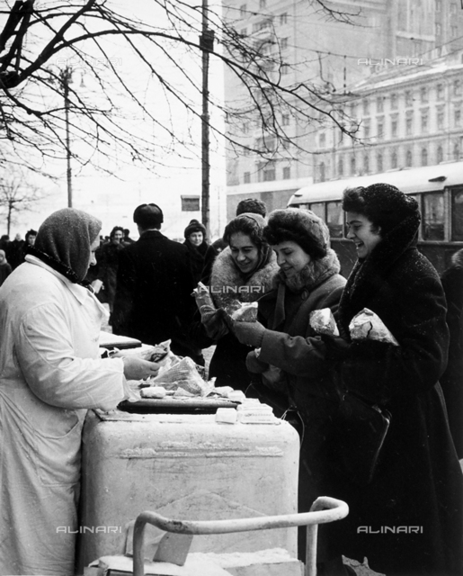 Women buying ice-cream from an ice-cream cart, in Revolution Square in Moscow, Russia
