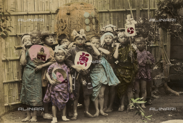 Group of Japanese children posing for a photo.