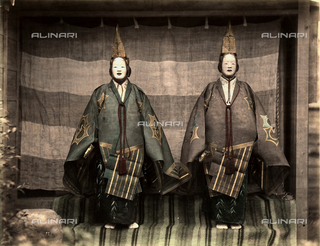 Two actors in traditional japanese theatre costumes