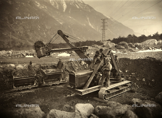 Workers and machinery continuing with the construction of a canal on the outskirts of Lausanne, Switzerland