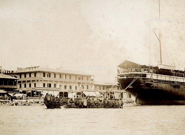 Port Said: a rowboat laden with coal workers bringing provisions to a boat