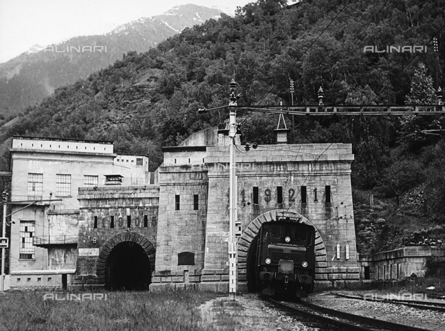 A locomotive coming out of the Simplon Tunnel