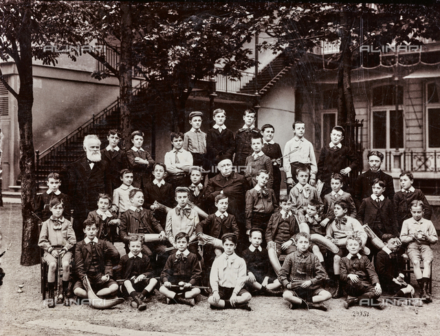 A class of pupils with teachers; modern reproduction of an ancient photograph