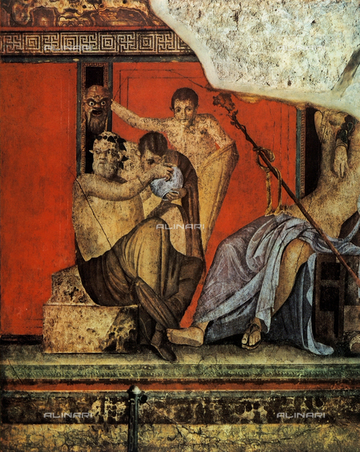 A Silen gives drink to a satyr while another Silen holds up a theatrical mask; detail of frescoes on a red field of the II style. The Villa of Mysteries, Pompeii
