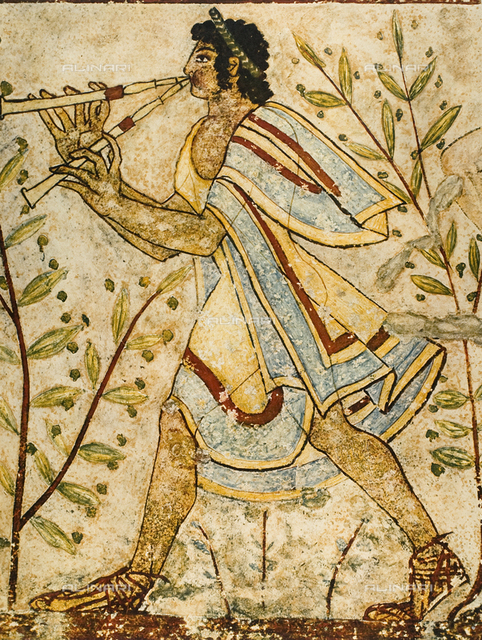 A musician playing the double flute. Detail of a wall painting in the Tomb of the Leopards in Tarquinia