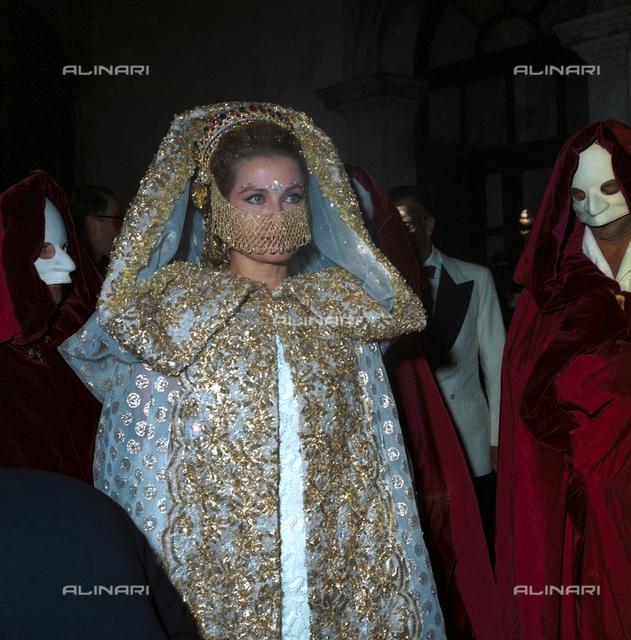 Grace Kelly attending a masquerade party in Ca' Rezzonico, Venice