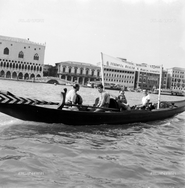 Gondoliers providing service to the train station of Venice