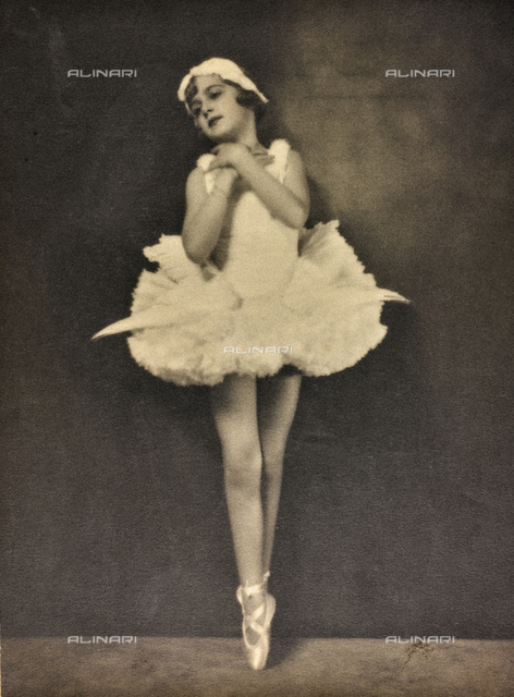 Little girl in tutu dancing on her toes