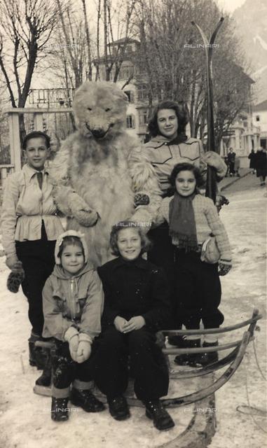 Group portrait with a white bear, symbol of Cortina d'Ampezzo, Belluno