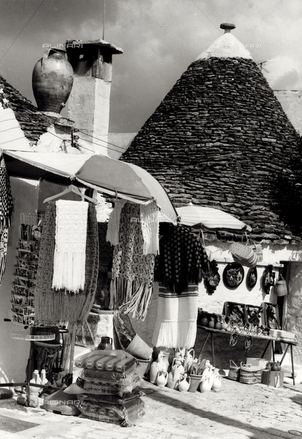 Stalls and shops in the streets of Alberobello, Bari