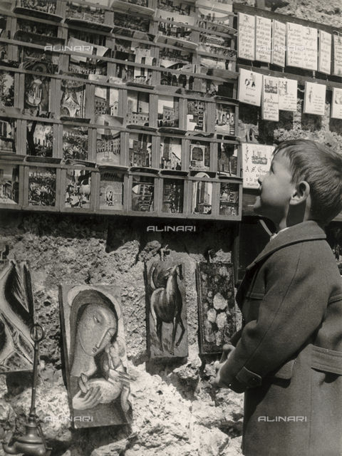 """""""San Gimignano with Alexander"""", portrait of little boy as he watches the display of postcards"""