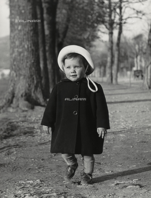 """Elena with hat in garden"", portrait of little girl"