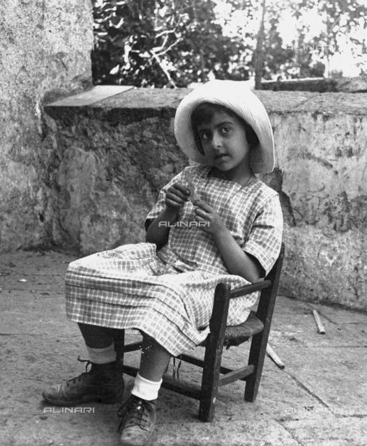 """""""Little girl on a chair at Villa Belvedere"""""""