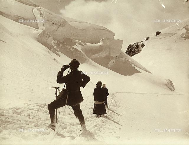 Mountain climbers in high mountain snow